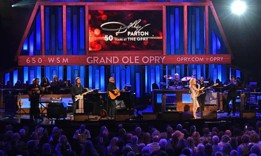 Dolly Parton performs at the Grand Ole Opry in Nashville.