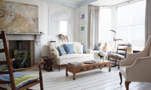 Ocean going: the bright sitting room with its wonderful view of the coast and the tower.