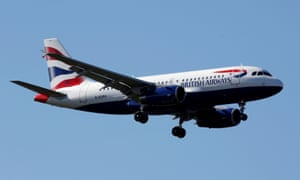 A British Airways plane soars in the sky.