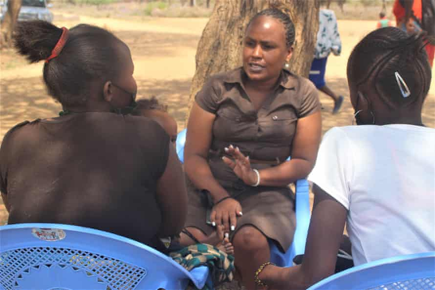 Patricia Makau (centre) of VSO Kenya with 19-year-old Susan Kamiti and 17-year-old Lucy Koriang.