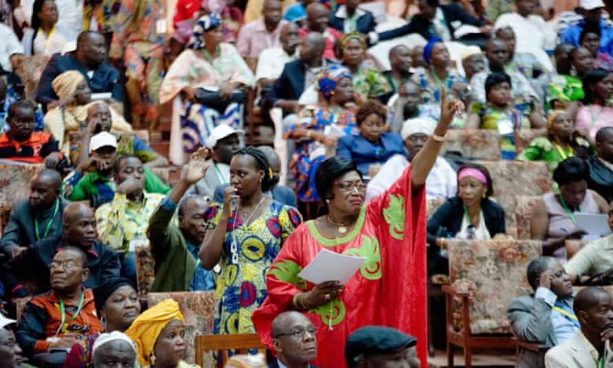 Women stand at the Bangui National Forum in Central African Republic in May