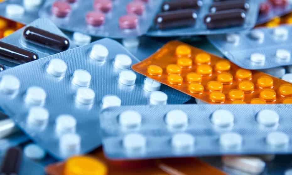 An array of prescription medications in blister packs