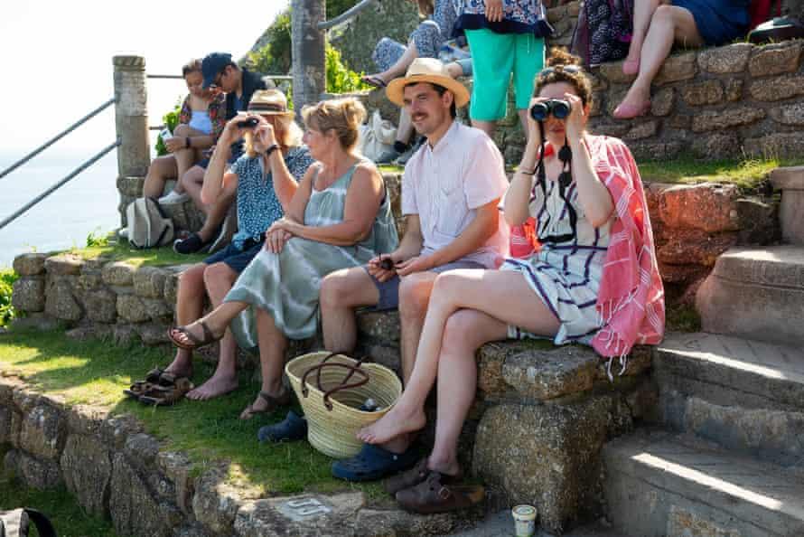 Spectators with binoculars