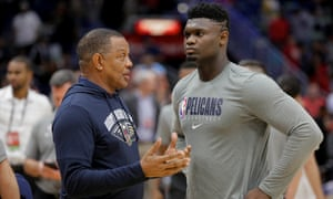 Zion Williamson talks to his head coach, Alvin Gentry, during a team practice