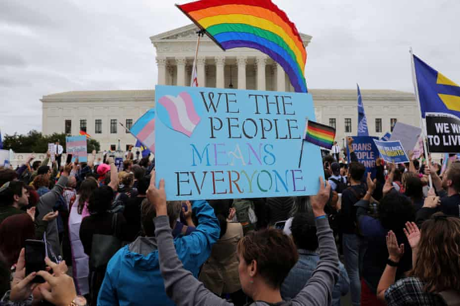 LGBTQ+ activists and supporters rally outside the US supreme court in Washington DC.