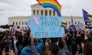 Activists and supporters hold a rally outside the US supreme court as it hears arguments in a major LGBTQ+ rights case.