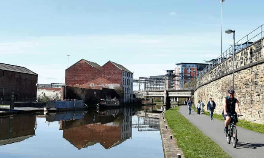 Walkers and cyclists by the Leeds and Liverpool Canal in Leeds. The city has been named one of the top European destinations by Lonely Planet.