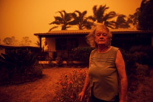Nancy and Brian Allen at their home in Nowra, NSW, as a fire rages near the town.