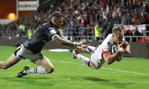 Adam Swift goes over for a try past Castleford Tigers' Ben Crooks during the sides' Super 8s match at Langtree Park.