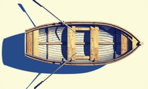 High angle view of rowboat and oars floating