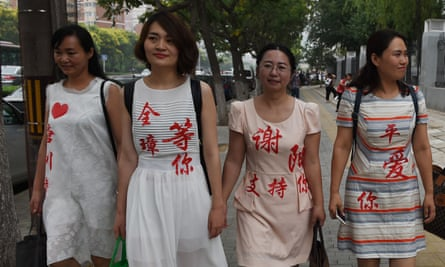 Chen Guiqiu (3rd L), the wife of detained human rights lawyer Xie Yang, with other wives of detained human rights lawyers wearing the names of their husbands on their dresses in 2016.