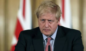 Britain's Prime Minister Boris Johnson holds a news conference to give the government's response to the coronavirus outbreak, at Downing Street in London.