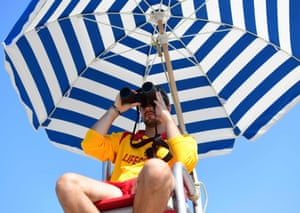 A lifeguard keeps watch at Kits Beach in Vancouver