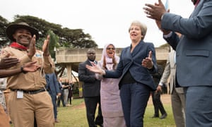 Theresa May celebrates bowling strike
