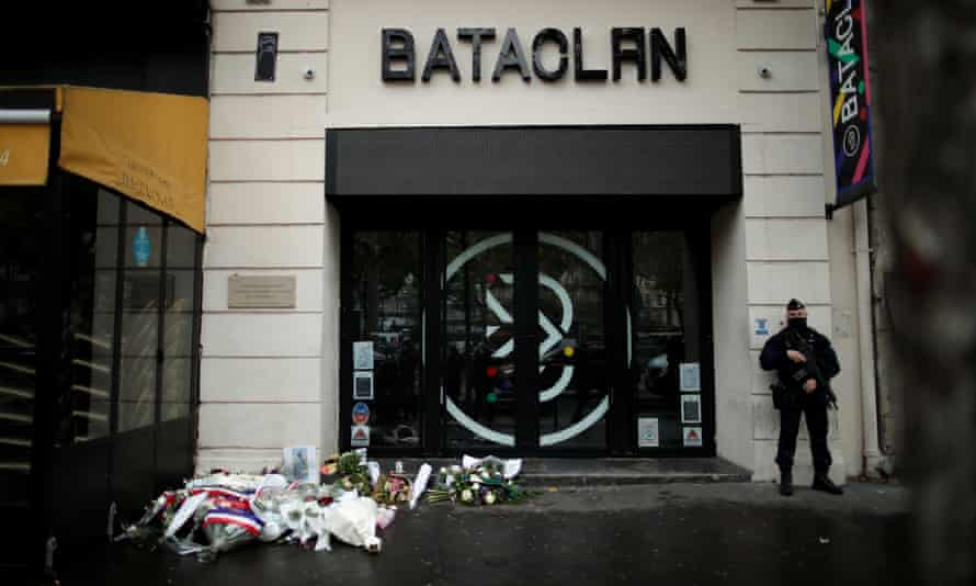 A police officer stands guard in front of the Bataclan concert venue during a ceremony marking the fifth anniversary of the terror attacks in Paris, France