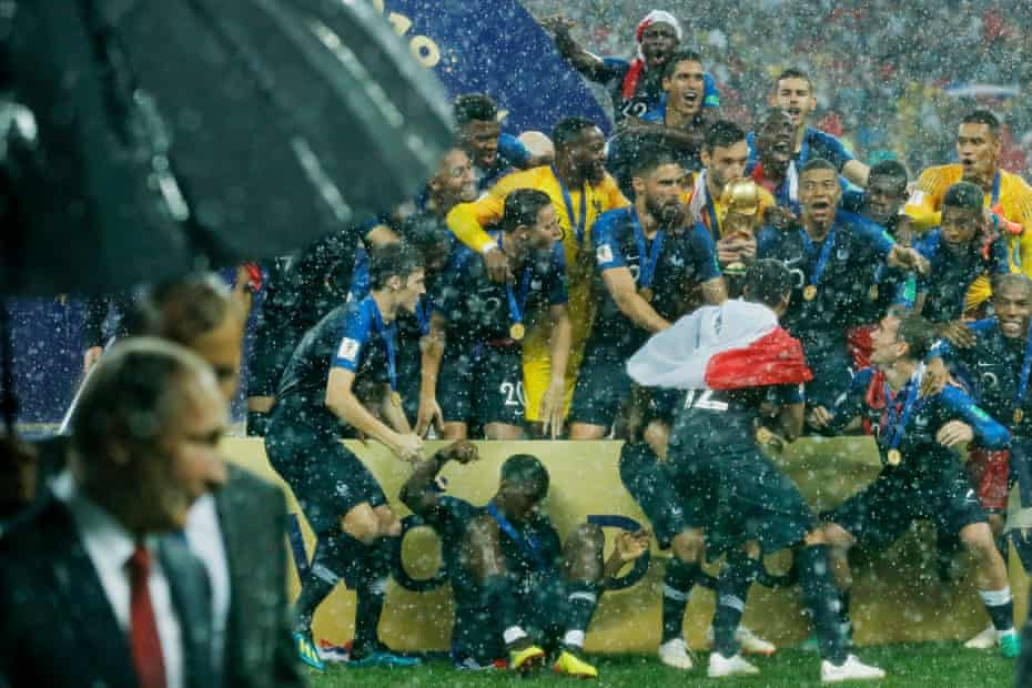 Just as Hugo Lloris and the rest of the French team lift the trophy, President Vladimir Putin and his entourage walk in front of the photographers after the France v Croatia FIFA World Cup 2018 final