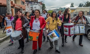 Acción Ecológica representatives and supporters walk through Quito yesterday to the Ministry of Environment.