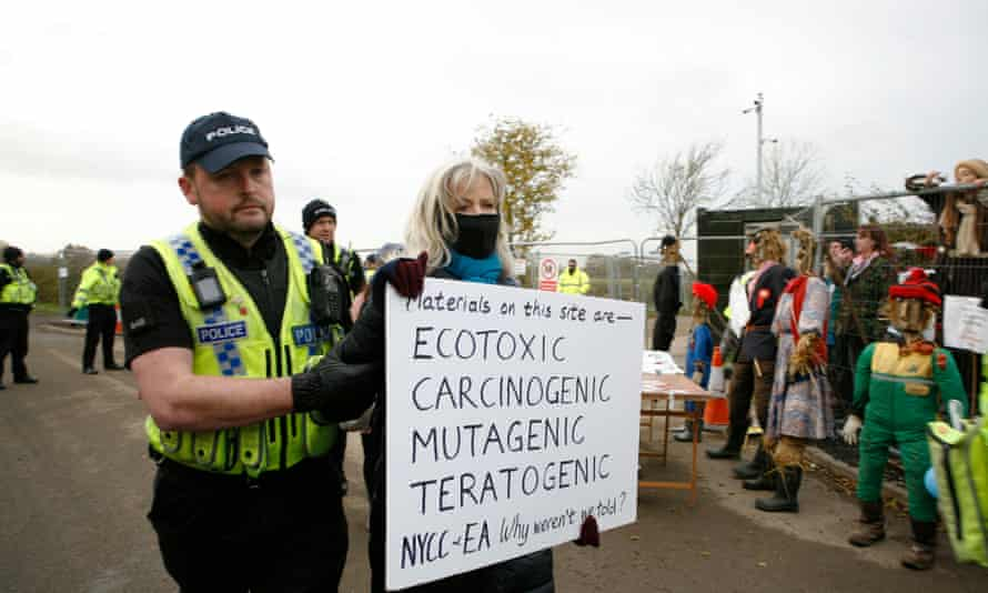 A protester is led away during a demonstration at Kirby Misperton in North Yorkshire, where final consent for fracking is expected to be given in December.