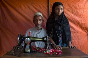 Amir Khan, 63, with his daughter Umme Habib, 20, with their sewing machine, in Hakinpara camp