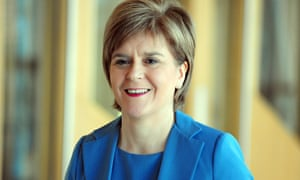 Nicola Sturgeon makes her way to the weekly session of First Minister's questions in the Scottish Parliament, 23 Apr 2015.