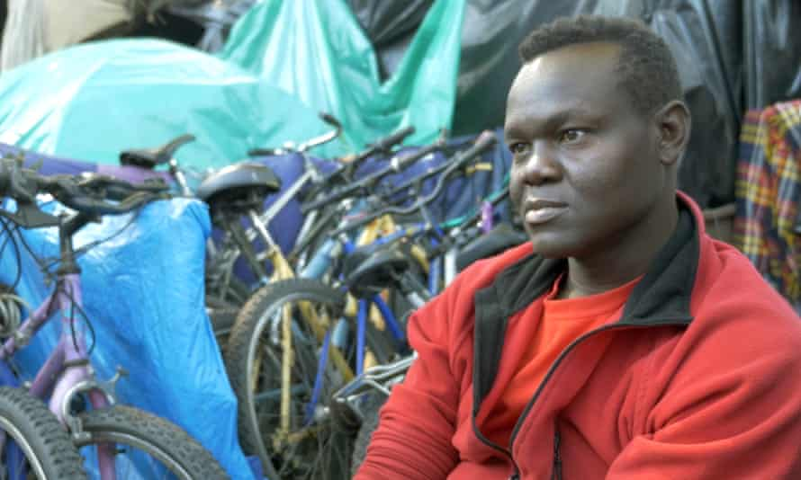Adil and his bikes in the Jungle, Calais.