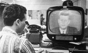 A Cuban exile in Miami watches President Kennedy address the nation in 1962