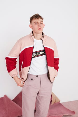 Logo printed black T-shirt, pink and red puffer jacket, pink trousers, silver-sterling ID-bar necklace