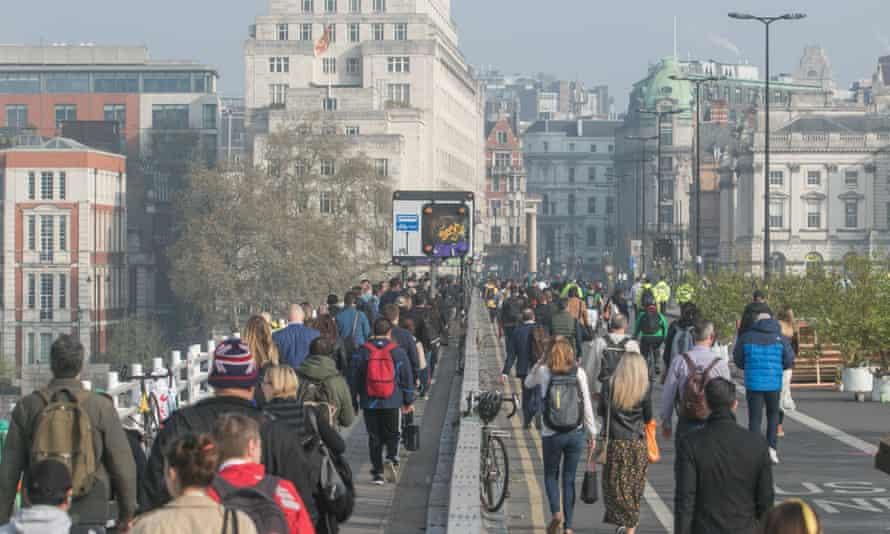 Commuters on Waterloo Bridge during London's Extinction Rebellion protest.