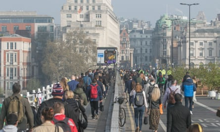 Commuters on Waterloo Bridge during London's Extinction Rebellion protest.