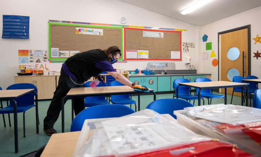 Tables being disinfected at Queen's Hill Primary School in Costessey, near Norwich, 24 August 2020.