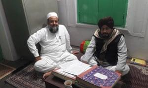 Shaair Ullah Khan Wajeehi, joint secretary of the Jame-Ul-Uloom Furqania madrasa, with Mohammed Rahman Khan, the school's principal