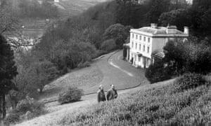 Agatha Christie with her husband Max Mallowan outside their Devon home, Greenway House.