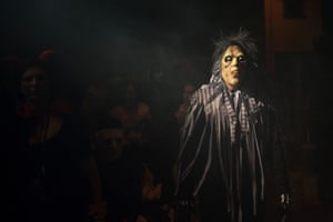 Spain's version of the zombie: a woman looms out of the darkness of Halloween celebrations in Churriana near Malaga.