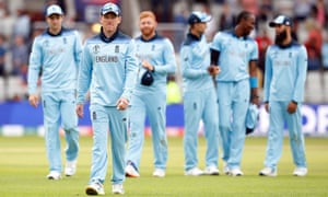 Eoin Morgan and the England players leave the field after victory over Afghanistan.