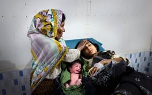 Cox's Bazar, Bangladesh20-years-old Hosna Ara just gave birth to her 3rd child at IOM medical centre in Kutupalong Camp. Her mother, Minarva is proudly holding her grand daughter.