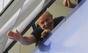 Brazil's former President Luiz Inacio Lula da Silva waves to supporters from a window of the Metal Workers Union headquarters in São Bernardo do Campo, Brazil, before he was later jailed for corruption on the same day.