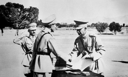 Reza Shah hands his son Ali Reza commission as an officer at graduation exercises in Tehran in 1941.