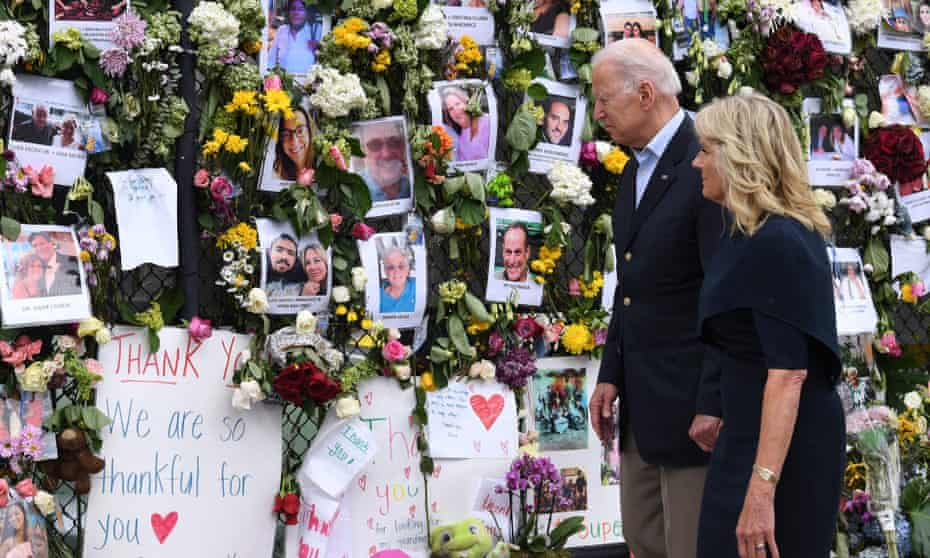 Joe and Jill Biden at a memorial wall near the condo site in Surfside. Biden said: 'The families are realistic. They know that the chances are, as each day goes by, diminished.'