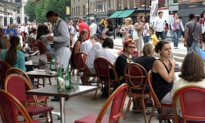 People eat outside a cafe