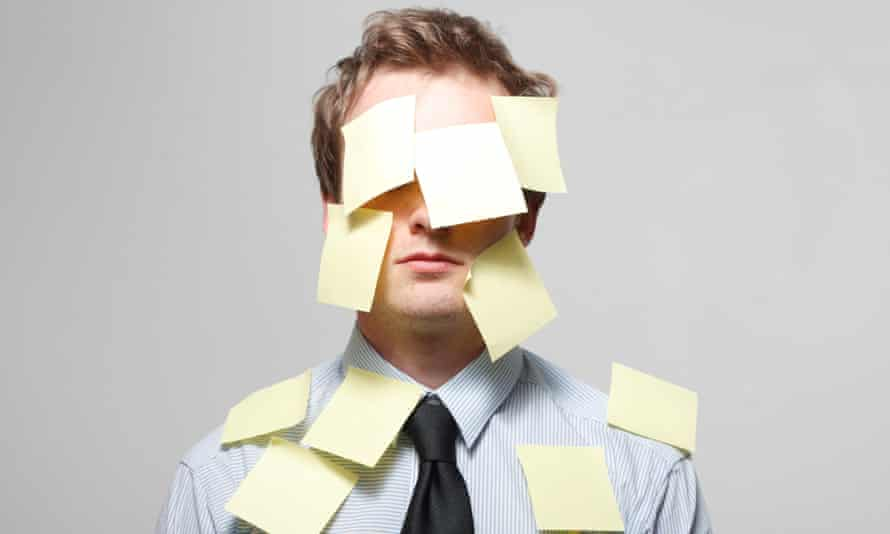 Man with Post-It notes all over his face