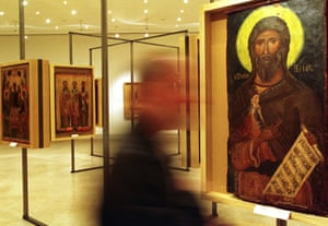 A visitor walks by a 12th century icon depicting the Prophet Elijah at the Athens' Byzantine and Christian Museum