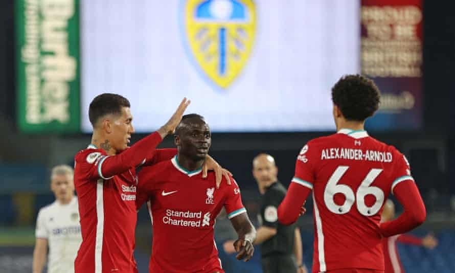 Sadio Mané celebrates his goal with Roberto Firmino and Trent Alexander-Arnold.