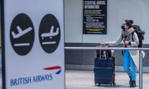Warning signs about the new rules are on the wall at Heathrow airport, on the day the new quarantine restrictions came in to force for international travel from a red list of countries, 15 February 2021