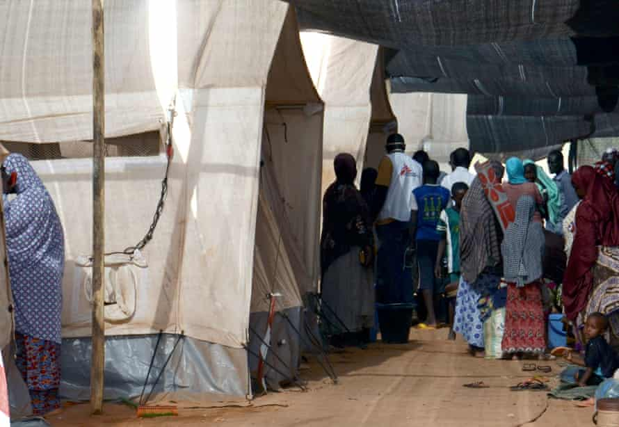 People gather at the health centre in Lazaret, near Niamey in Niger, in April 2015, where patients suffering from meningitis are being treated.