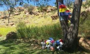 A memorial for a child who died after allegedly sniffing solvents on Billy Goat Hill in Alice Springs. The gathering spot is just metres away from a youth service that closed recently due to funding cuts.