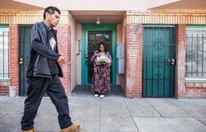 Paula Beal picks up mail from the Oakland apartment she has been forced to leave.