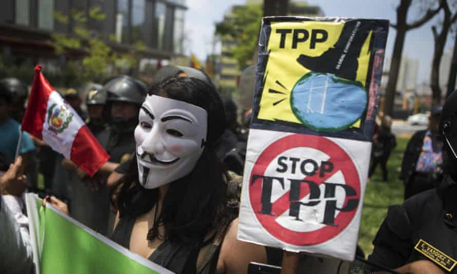 People protest against the Trans Pacific Partnership in Lima, Peru.