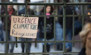 A placard reading 'climate emergency, let's react' in downtown Paris on Friday