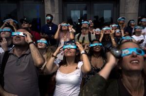 People in cardboard glasses