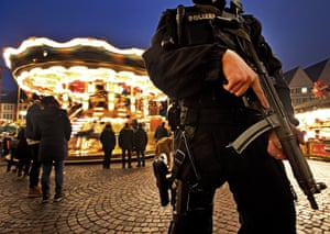 Frankfurt, GermanyA German police officer stands near a merry-go-round guarding the Christmas market